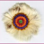Seed beads on leather surrounded by rabbit fur