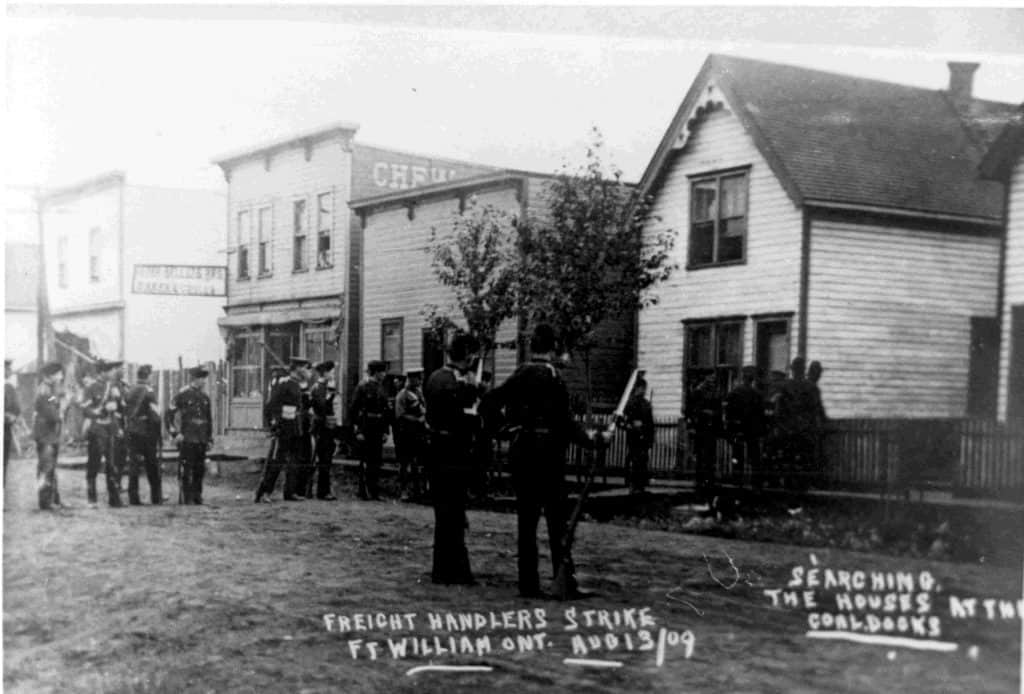 Militia units searching houses along McTavish Street during the Freight Handler's Strike of 1909. TBHMS 974.71.84A